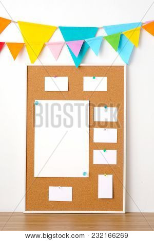 Colorful Party Flags Hanging On Cork Board With Blank Note Papers On Wooden Table Background, Birthd