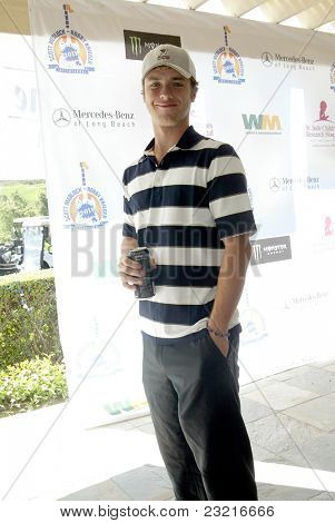 MOORPARK, CA - AUG. 29: Jeremy Sumpter arrives at the 4th annual Scott Medlock-Robby Krieger Concert & Golf Classic on Aug. 29, 2011 at the Moorpark Country Club in Moorpark, California.