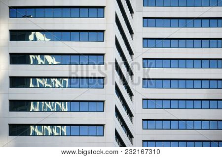 Abstract Reflections Of Surrounding Buildings In The Windows Of A Modern Skyscraper.