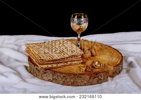Jewish Symbols For The Passover Holiday Concept With Wine And Matzoh Over Rustic Background With Cop