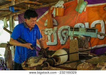Lampang, Thailand - November 3, 2012: Carpenter Lathing A Piece Of Wood By Using Lathe Machine To Ma