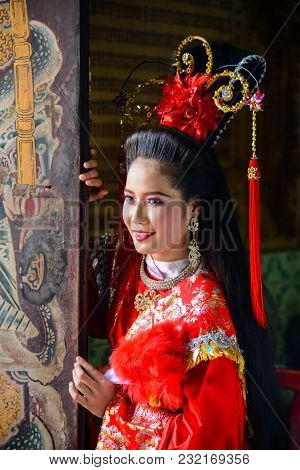 Chachoengsao, Thailand - July 14, 2013 : Beautiful Woman With Traditional Chinese Red Dress At Chine