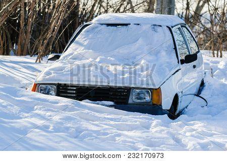 Nizhny Novgorod, Russia - March, 10, 2018: snow-capped car on the parking in Nizhny Novgorod in winter