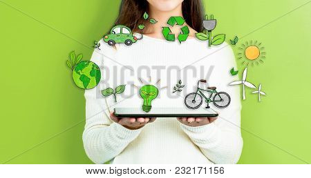 Ecology With Woman Holding A Tablet Computer