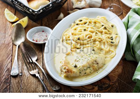 Chicken Piccata With Garlic Lemon Sauce And Capers Served With Linguini