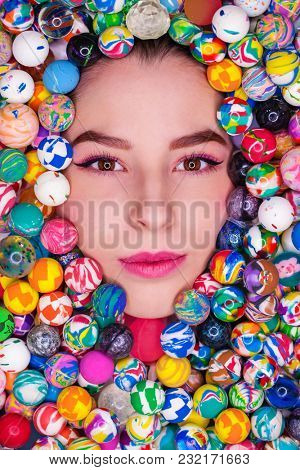 Portrait of a young girl in rubber balls