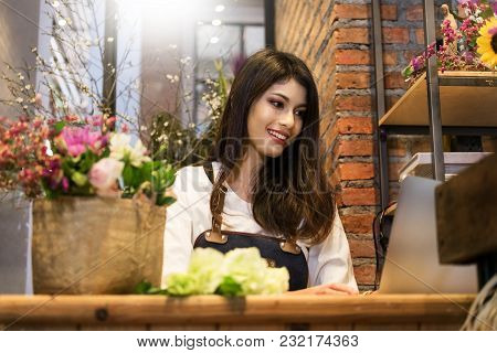 Women Florist Looking Laptop Got Order At Counter Of Her Flower Shop, Occupation Working Concept.