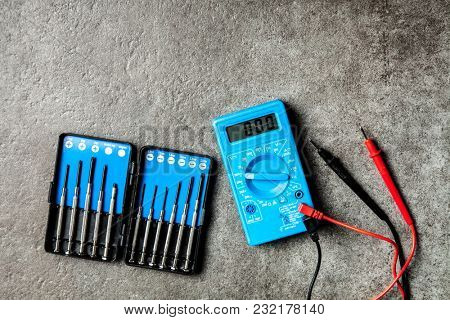 Digital multimeter on grey background