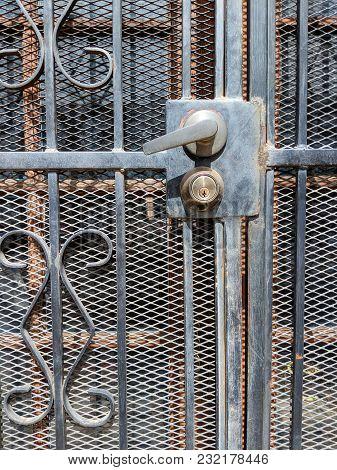 Handle And Key Lock On Wrought Iron Security Screen Door