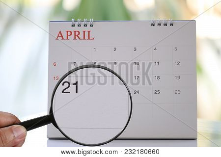 Magnifying Glass In Hand On Calendar You Can Look Twentieth One Day Of Month,focus Number Twenty-one