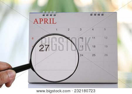 Magnifying Glass In Hand On Calendar You Can Look Twenty Seven Day Of Month,focus Number Twenty Seve
