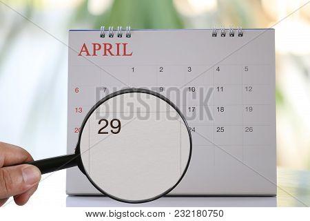 Magnifying Glass In Hand On Calendar You Can Look Twenty-nine Day Of Month,focus Number Twenty-nine