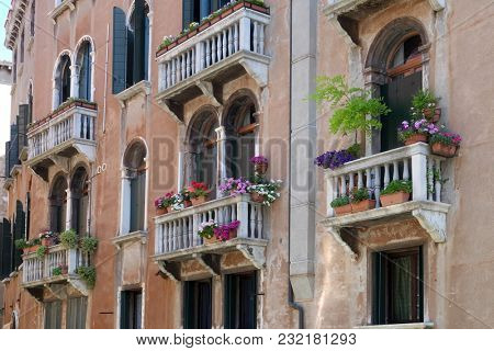 VENICE, ITALY - MAY 28: Flowers and plants in balcony of old, historical, typical building in Venice. Image shows architectural style and lifestyle of the region in Venice , Italy on May 28, 2017.