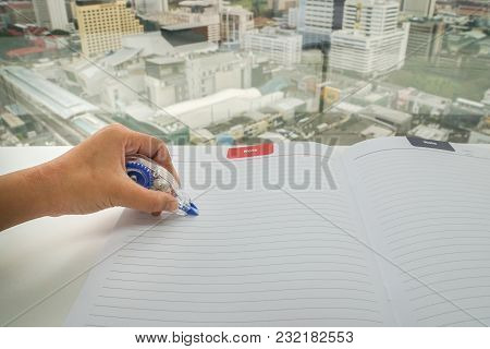 Close Up Woman Uses 3 On Mock Up Paper Sheet For Mistake Removal
