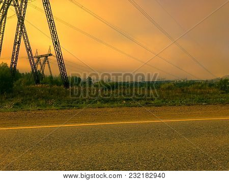 Power Transmission Line Of Powerful Power Plant. Power Line In The Sunset. In The Background You Can