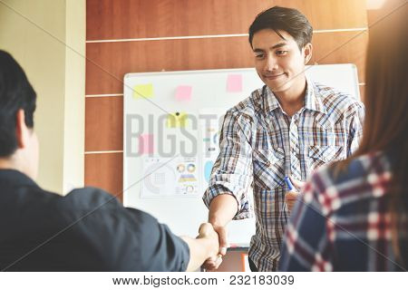Confident Asian Creative Male Designer Making A New Business Presentation Project To A Group.