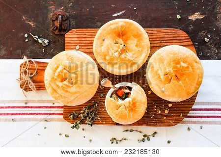 Chicken Pot Pies With Carrot And Green Peas On A Wooden Table. Easter Food. Rustic Style. Comfort Fo