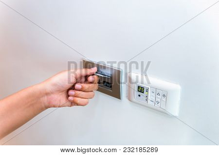 Close Up Of Female Hand Inserting Key Card To Unlock A Door In The Hotel.