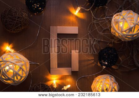 Alphabet Dominoes And Decorative Lights Background, Alphabets Concept.
