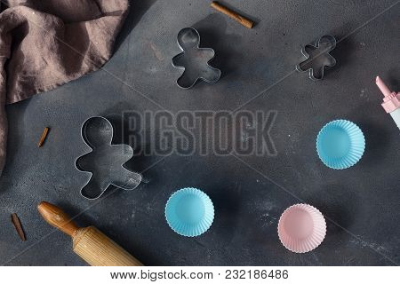 Bakery Background. Frame Of Bakeware And Rolling Pin On Dark Background Top View