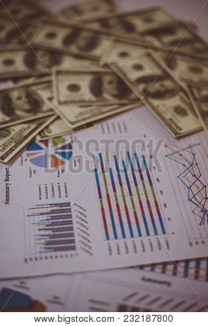 Business Documents On Workplace With Dollar Usd Money On Background.