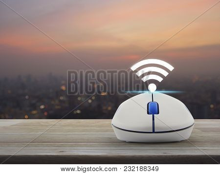 Wi-fi Button With Wireless Computer Mouse On Wooden Table Over Blur Of Cityscape On Warm Light Sundo