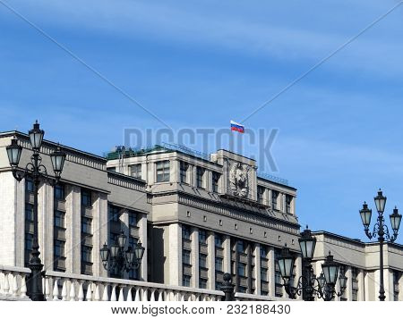 Russian Flag Over The Building Of The State Duma (russian Parliament) In Moscow