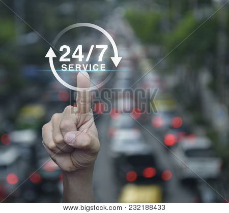 Hand Pressing Button 24 Hours Service Icon Over Blur Of Rush Hour With Cars And Road, Full Time Serv
