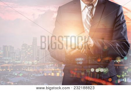 Double Exposure Of A Businessman And A City Using A Smart Hand Holding Phone Futuristic Connection T