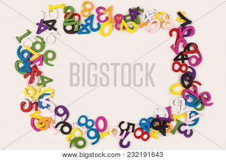 Color Numeral Arithmetic On White Wooden Background