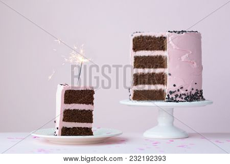 Chocolate layer cake with sparkler