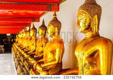 View On Golden Buddha Sculptures By Temple Wat Pho In Bangkok