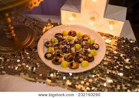 Chocolate Sweets With Nuts Laid Out On A Plate