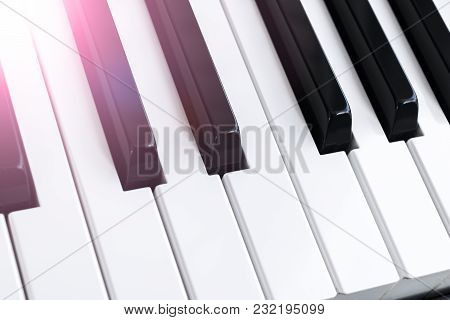 Top View Of Piano Keys. Close-up Of Piano Keys. Close Frontal View. Piano Keyboard With Selective Fo