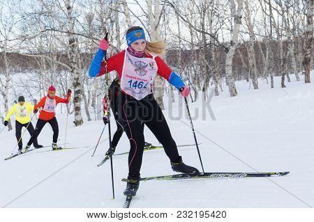 Petropavlovsk, Kamchatka Peninsula, Russia - February 10, 2018: Pretty Young Sportswoman Running On