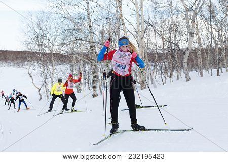 Petropavlovsk, Kamchatka Peninsula, Russia - February 10, 2018: Young Sportswoman Running On Skis In