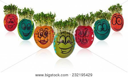 Easter Egg Painted In A Funny Smiley Girl Face And Colorful Patterns With Cress Like Hair.