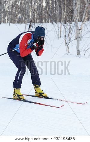 Petropavlovsk, Kamchatka Peninsula, Russia - Feb 10, 2018: Sportswoman Skier Riding From Mountain On