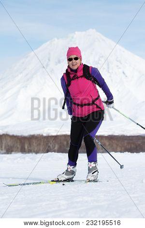 Petropavlovsk City, Kamchatka Peninsula, Russia - Feb 10, 2018: Sportswoman Skier Running Along The