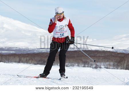 Petropavlovsk City, Kamchatka Peninsula, Russian Far East - Feb 10, 2018: Sportswoman Skier Running