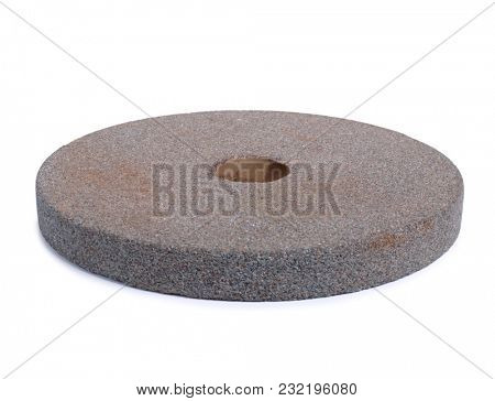 Stone for sharpening knives on a white background