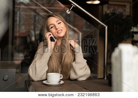 Communication, Technology, Leisure And People Concept - Happy Young Woman Or Teenage Girl Calling On