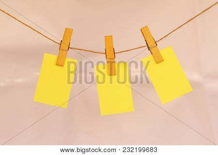 Blank Sticky Notes Hanging With Cloth Pins On Clothes Line Close View