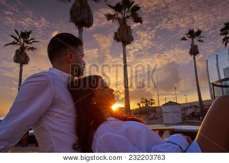 Couple young hug in beach vacation sunrise in Spain