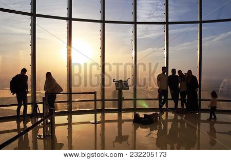 Dubai - January 28, 2017: Tourists Meet Sunrise At The Observation Deck At The Top Of Burj Khalifa.