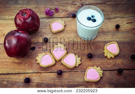 Yoghurt Or Milk In A Glass, Strawberry Shape Cookies With Berry Cream, Red Apples And Black Currant