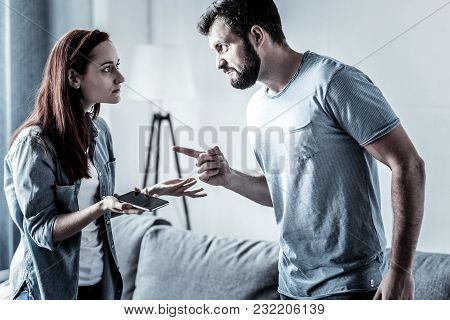 You Will Be Sorry. Angry Unshaken Furious Man Standing In The Bright Room Feeling Stressful Himself