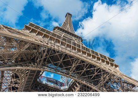 Low angle view of Eiffel Tower against clouds in sky, Paris, France