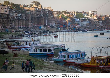 VARANASI, INDIA - MAR 18, 2018: Banks on the holy Ganges river. According to legends, the city was founded by God Shiva about 5000 years ago.