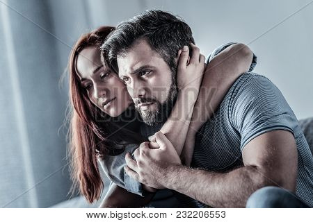 Dont Leave Me. Calm Lovely Cute Couple Sitting In The Bright Room Spending Time Together And Hugging